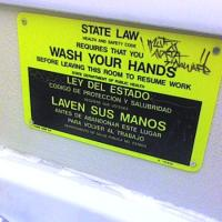 """Wash your hands"": one of the signs written in Spanish"